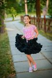 Beautiful cheerful girl in a tutu skirt dancing and smiling
