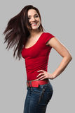 Beautiful cheerful girl with fluttering hair Royalty Free Stock Photography