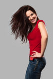 Beautiful cheerful girl with fluttering hair Stock Images