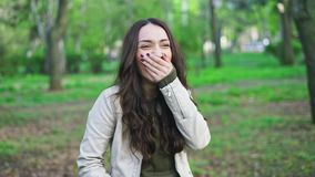 Beautiful and cheerful girl wondeering and harshly laughing stock footage