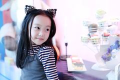 Beautiful cheerful little girl playing pleasure ground on playground Stock Photography