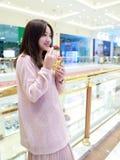 Beautiful cheerful girl eat ice cream Stock Images