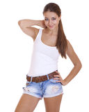 Beautiful cheerful teen girl in blue jean shorts. Beautiful cheerful teen girl in jean shorts, on white background royalty free stock photo