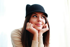 Beautiful cheerful woman in cute hat looking away Stock Images