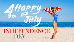 Beautiful cheerful woman holding an American flag on the beach stock images