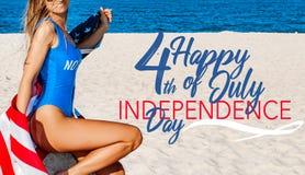 Beautiful cheerful woman holding an American flag on the beach stock photos