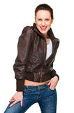 Beautiful cheerful woman in leather jacket Royalty Free Stock Images