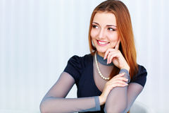 Beautiful cheerful woman looking right at copyspace Royalty Free Stock Images