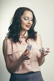 Beautiful and cheerful woman opening small gift box and smiling. Holiday and gift concept. Beautiful and cheerful woman opening small gift box and smiling Royalty Free Stock Photography