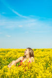 Beautiful cheerful woman on spring field Stock Images