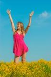 Beautiful cheerful woman spring field Stock Photo