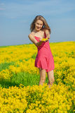 Beautiful cheerful woman spring field Stock Photo