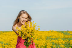 Beautiful cheerful woman spring field Royalty Free Stock Images