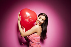 Beautiful cheerful woman with valentines day balloon Royalty Free Stock Images