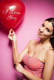 Beautiful cheerful woman with valentines day balloon Stock Image