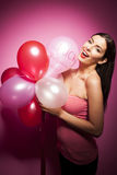 Beautiful cheerful woman with valentines day balloon Stock Images