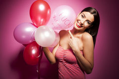 Beautiful cheerful woman with valentines day balloon Royalty Free Stock Photo
