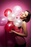 Beautiful cheerful woman with valentines day balloon Stock Photo