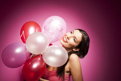 Beautiful cheerful woman with valentines day balloon Royalty Free Stock Photos