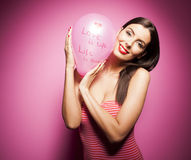 Beautiful cheerful woman with valentines day balloon Stock Photography