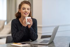 Beautiful cheerful young woman holding coffee cup stock images