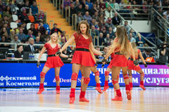 Beautiful cheerleaders. MOSCOW, RUSSIA - JANUARY 27, 2017: Group of excited young cheerleaders of CSKA team dance on basketball game CSKA vs Anadolu Efes on Stock Photo