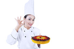Beautiful chef serve delicious cake Royalty Free Stock Photography