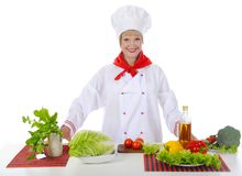 Beautiful chef prepares breakfast. Stock Photography