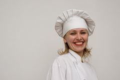 Beautiful chef showing on a light background Royalty Free Stock Images