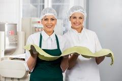 Beautiful Chefs Holding Spaghetti Pasta Sheet Stock Image