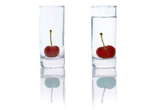Beautiful cherries in a small glass Royalty Free Stock Photography