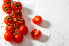 Beautiful cherry tomatoes on branch. stock photos