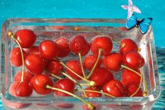 Beautiful cherry in water with bubbles Royalty Free Stock Images