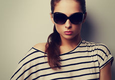 Beautiful chic lady posing in fashion sun glasses. Closeup color Royalty Free Stock Image