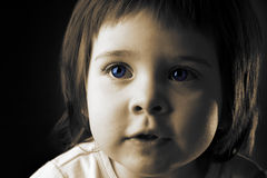 Beautiful child. Beautiful face of a little gilr with blue eyes Stock Images