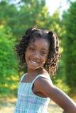 A beautiful child. A beautiful african american child enjoying the outdoors Stock Image