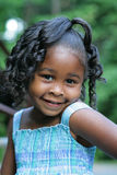 A beautiful child. A beautiful african american child enjoying the outdoors Royalty Free Stock Photos