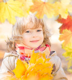 Beautiful child in autumn Stock Photography