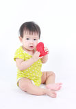 Beautiful child, baby holding a red heart. Stock Photo