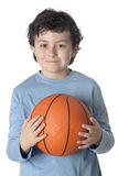 Beautiful child with basket ball Stock Photos
