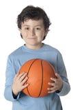 Beautiful child with basket ball Stock Photos