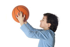 Beautiful child with basket ball shooting Royalty Free Stock Photo