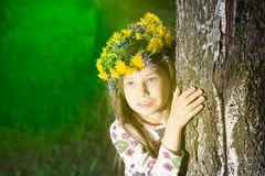 Beautiful child blowing away dandelion flower in spring. Royalty Free Stock Photography