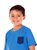 Beautiful child with blue tshirt and black hair Royalty Free Stock Images