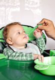 Beautiful child boy feeding by his father Royalty Free Stock Photo