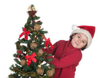 Beautiful child with Christmas trees Royalty Free Stock Photos
