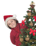 Beautiful child with Christmas trees Royalty Free Stock Photography