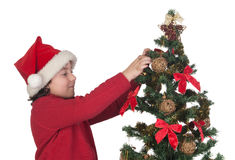 Beautiful child with Christmas trees Stock Photos