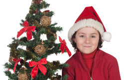 Beautiful child with Christmas trees Royalty Free Stock Images