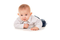 Beautiful the child in clothes crawling on the floor Royalty Free Stock Image